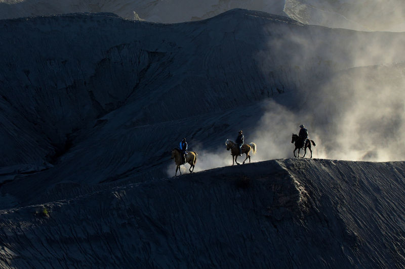 People riding on mountain