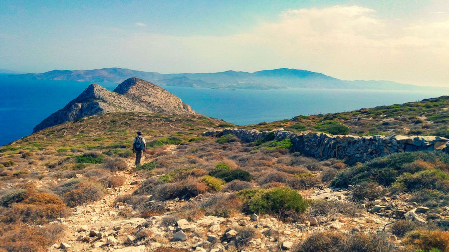 Sikinos Mountains Distant People Nature Blue Sky Greece person Green Summer Holiday People Photography Sikinos Sea Seascape Sea And Sky Island Cyclades Treking The Traveler - 2018 EyeEm Awards Mountain Desert Arid Climate Sky Landscape Hiker Hiking My Best Photo