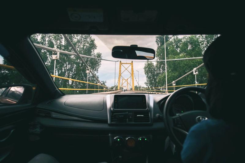 Man seen through car window
