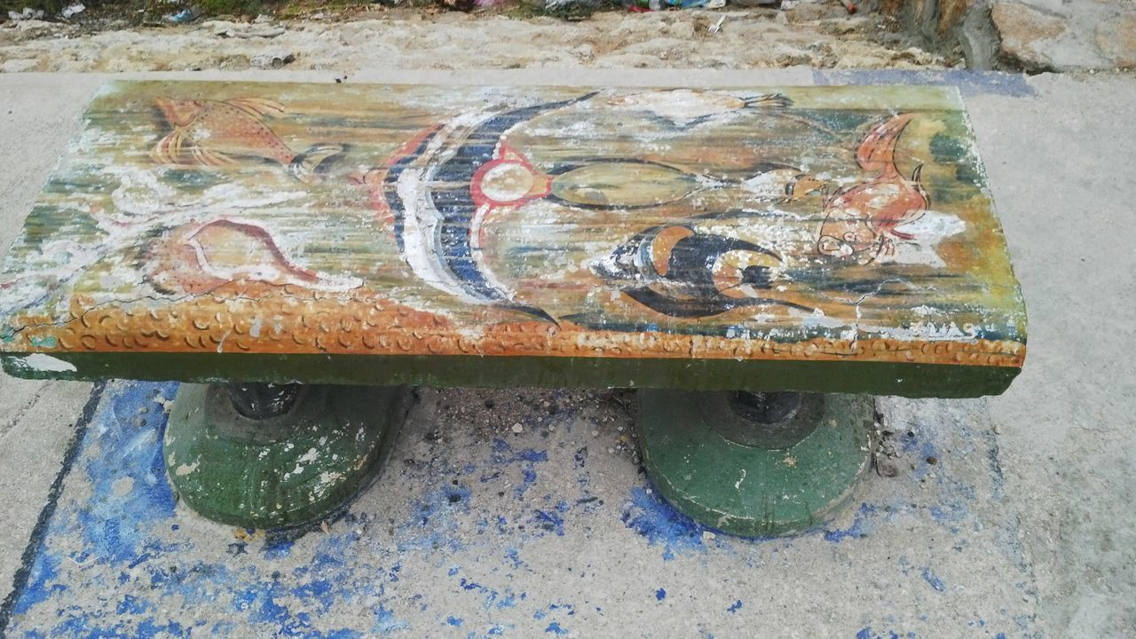 no people, day, high angle view, paint, indoors, metal, art and craft, close-up, directly above, old, body part, rusty, transportation, weathered, flooring, wheel