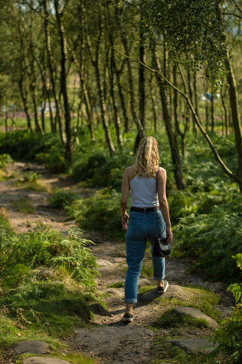 Rear view of woman walking in the forest