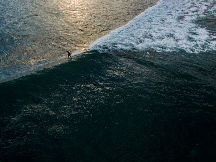 Aerial view of man surfing in sea