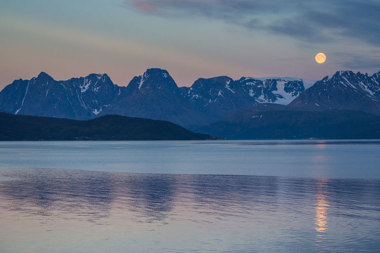 Arctic Beauty In Nature Cloud Cloud - Sky Fjord Full Moon Idyllic Landscape Majestic Moon Mountain Mountain Range Nature The Great Outdoors - 2017 EyeEm Awards Northern Norway Norway Outdoors Remote Moonset Season  Sky Snowcapped Mountain Tranquility Water Weather