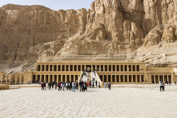 Group of people in front of ancient building