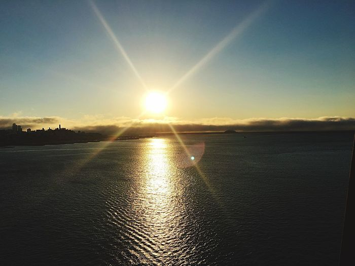 Sun Sunset Sunlight Beauty In Nature Scenics Sunbeam Nature Lens Flare Water Sky Tranquility Reflection Clear Sky Shadows & Lights Cityscape Sky And Clouds Sunset_collection Sunset Silhouettes Sunset #sun #clouds #skylovers #sky #nature #beautifulinnature #naturalbeauty #photography #landscape Outdoors No People Sea Day
