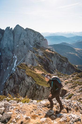 Woman hiking in alpine landscape in autumn, bischofsmütze, annaberg, austria