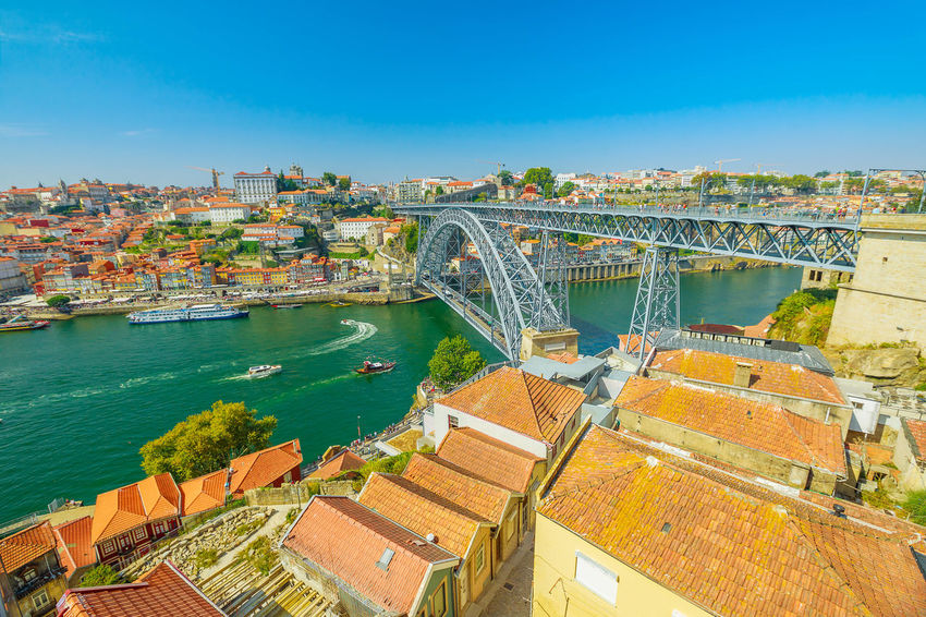 Picturesque Oporto urban landscape. Aerial view of Dom Luis I on Douro River and city skyline, Vila Nova de Gaia, Porto in Portugal. Sunny beautiful day. Portugal Porto Tourism City Aerial View Cloudscape Cityscape Landscape Panorama Europe People Church Church Architecture Architecture Town Porto Portugal 🇵🇹 Monment Oporto City Oporto Downtown Oporto Streets Douro River Portugal River Sea Bridge Built Structure Building Exterior Water Connection Bridge - Man Made Structure Sky Nature Day Transportation No People High Angle View Building Travel Destinations Residential District Outdoors Arch Bridge