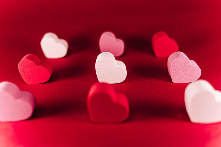 Close-up of heart shape against red background