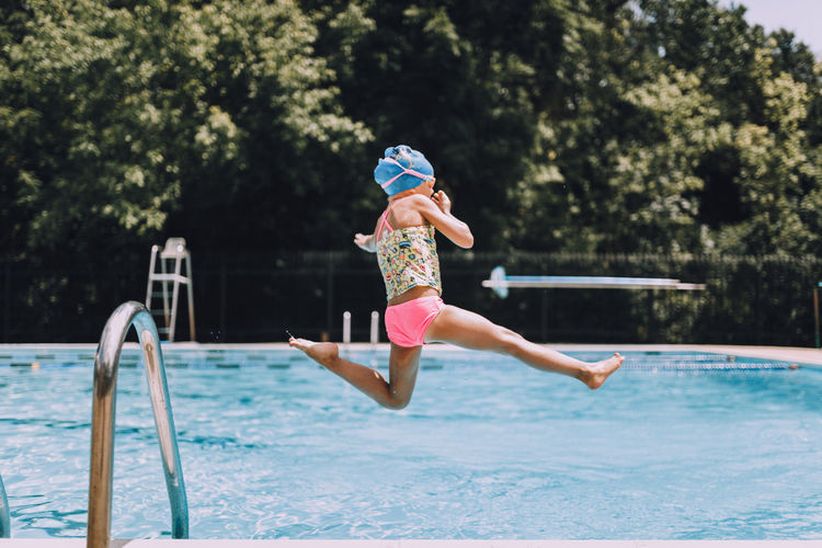 Child Childhood Children Day Jumping Mid-air One Person Outdoors People Real People Swim Swimming Swimming Pool Water