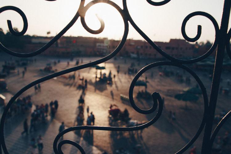 People seen through window in city