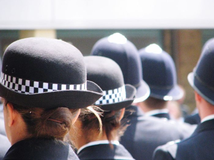 Rear View Of Police In Uniform