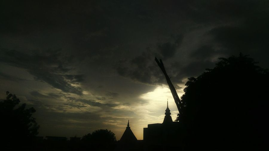 Low angle view of silhouette building against sky at sunset
