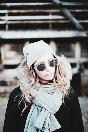 Adult Beautiful Woman Blond Hair Cold Temperature Fashion Focus On Foreground Hat Hipster - Person Knit Hat Knitted  Lifestyles One Person One Woman Only Only Women Outdoors People Portrait Real People Scarf Snow Sunglasses Warm Clothing Winter Women Young Adult Uniqueness Fashion Stories