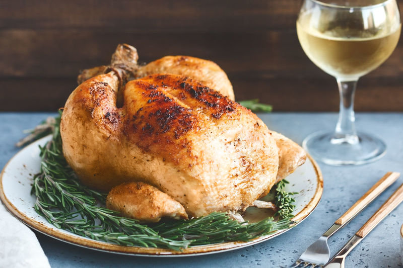 Close-up of roasted turkey in plate on table
