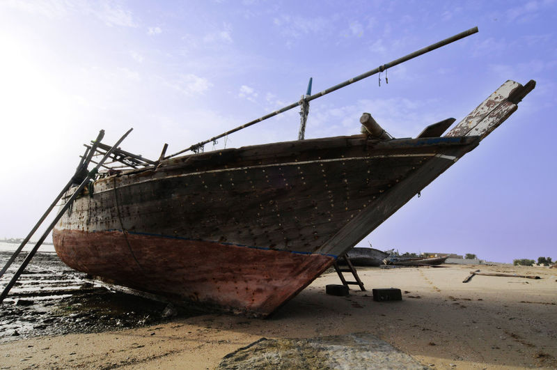 Abandoned Beach Boat Day Deterioration Mode Of Transportation Nautical Vessel Outdoors Qatar Sailboat Sea Ship Shipwreck Sky Transportation Water