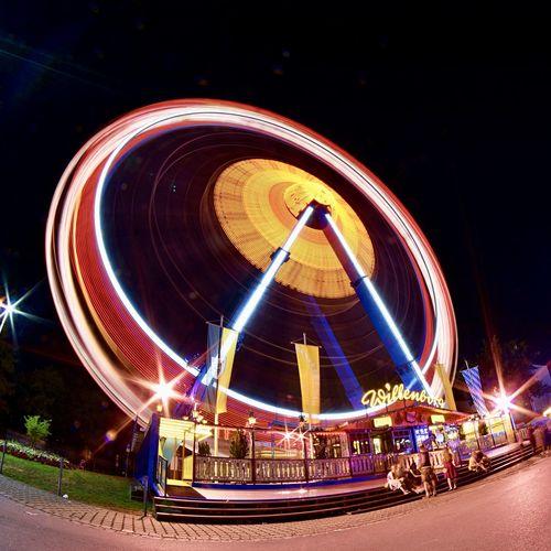 Gäubodenfest Straubing Riesenrad Amusement Park Amusement Park Ride Arts Culture And Entertainment Bayern Blurred Motion Ferris Wheel Glowing Gäubodenfest Illuminated Langzeitbelichtung Light Trail Long Exposure Motion Night Outdoors Speed Spinning