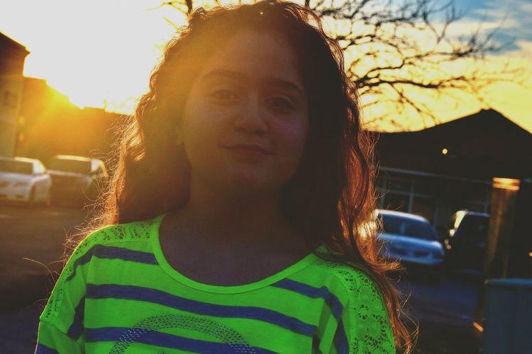 Portrait Of Teenage Girl On Street During Sunset