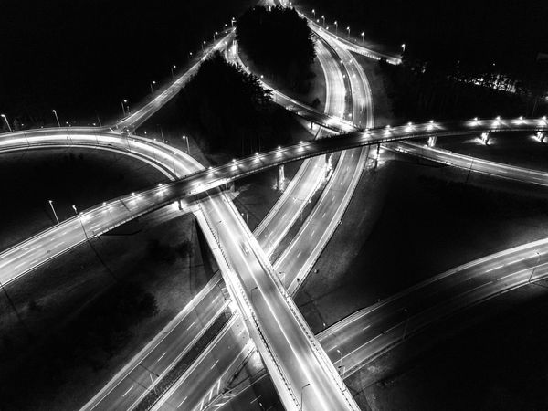 flyover - roads at night form drone - light trails black and white Architecture Areal Black And White Blurred Motion Bridge - Man Made Structure Cars Connection Drone  Flyover High Street Highway Illuminated Light Trail Long Exposure Motion Night Night Lights Outdoors Road Rush Hour Speed Street Street Light Traffic Transportation The Architect - 2017 EyeEm Awards