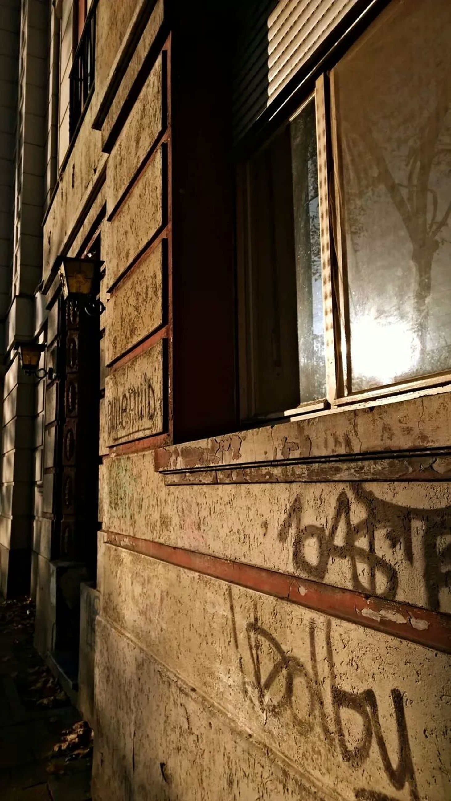 architecture, built structure, building exterior, window, old, building, abandoned, low angle view, wall - building feature, house, damaged, graffiti, no people, obsolete, day, door, weathered, residential structure, brick wall, sunlight