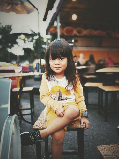 Portrait of girl sitting on chair