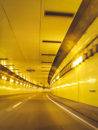 Freeway Road Tunnel City Illuminated Subway Train Yellow Futuristic Neon Speed Gold Colored Bridge - Man Made Structure Tunnel Public Transportation