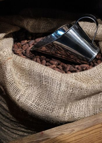 Indoors  Sack Still Life No People Food And Drink Textile High Angle View Container Close-up Food Wood - Material Table Freshness Jute Burlap Bag Large Group Of Objects Ingredient Spice Metal Personal Accessory Coco Beans Cocoa Beans Chocolate Beans
