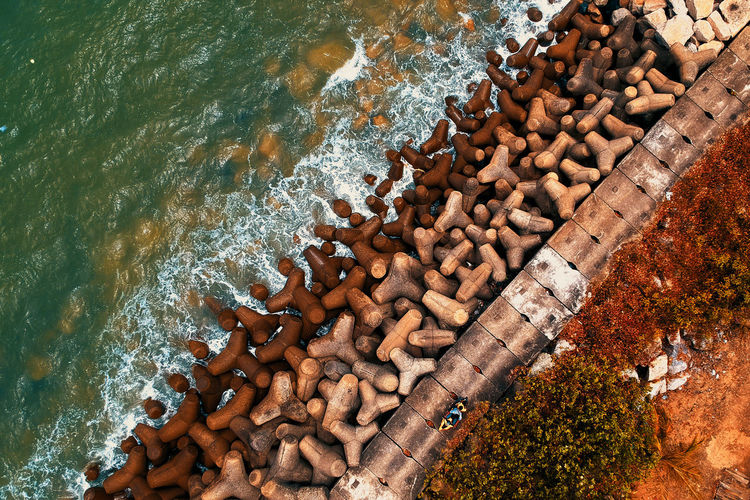 Water Day High Angle View Nature No People Solid Large Group Of Objects Outdoors Abundance Rock Stone - Object Land Rock - Object Tree Beauty In Nature Rusty Stack Sea Log Pebble