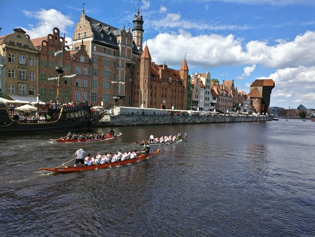 Architecture History Building Exterior Outdoors Day Sky Old Town River Boats Gdansk, Poland Sports Competition Riverside Teamwork
