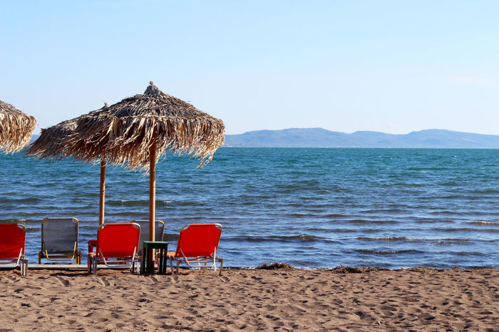 Beach Beach Umbrella Greece Horizon Over Water Idyllic Lesbos Lesvos Lounge Chair Parasol Relaxation Sand Scenics Sea Shore Thatched Roof Tourism Tranquil Scene Tranquility Travel Travel Destinations Vacation Vacations Water