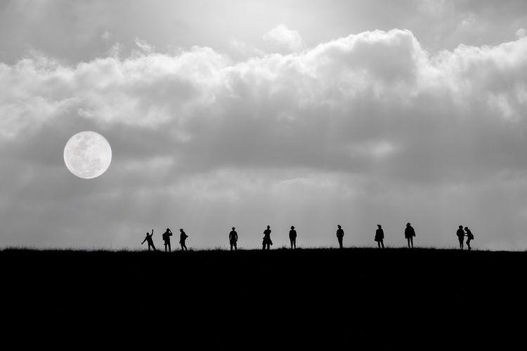 Silhouette People On Field Against Sky