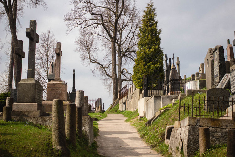 Low angle view of footpath at graveyard