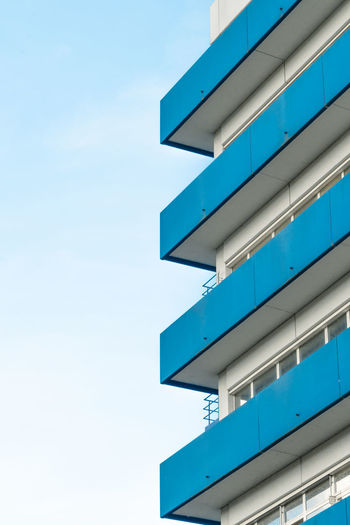 a blue building Built Structure Building Exterior Architecture Sky No People Blue Building Low Angle View Modern Day City Window Pattern Clear Sky Sunlight Glass - Material Repetition Residential District Apartment Nikon Architecture Architectural Column Minimalism Minimalist Architecture Geometric Shape