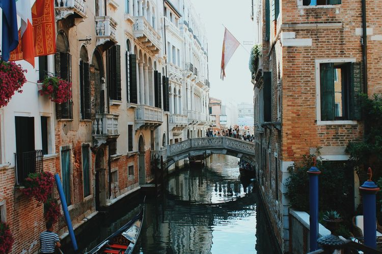 Bridge over canal amidst buildings in venice, italy