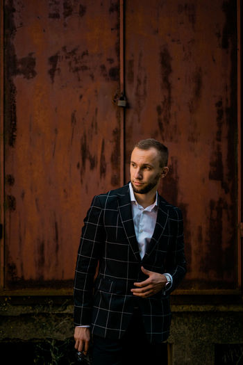 Man Stylish Adult Beautiful People Business Contemplation Front View Indoors  Looking Looking At Camera Man Fashion Man Style Men One Person Portrait Real People Standing Style Three Quarter Length Waist Up Wall - Building Feature Young Adult Young Men