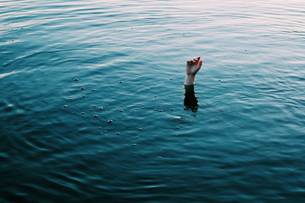 Person drowning in sea