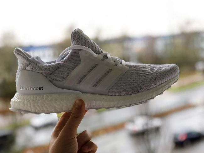 ❄️ Sneakerhead  Sneaker Boost White Hypebeast  Heat Winter Ultra Boost Adidasoriginals Ultraboost Adidas Human Hand Human Body Part Holding Focus On Foreground Real People One Person Unrecognizable Person Close-up Day Outdoors People Women