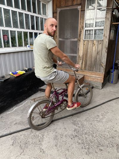 Portrait of man riding bicycle