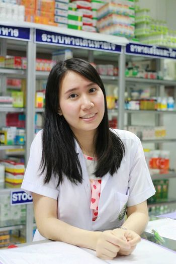 EyeEm Selects Retail  Store Portrait Looking At Camera One Person Shelf Front View Healthcare And Medicine Pharmacy Indoors  Supermarket Smiling Business Choice Women Occupation Young Women Working Real People Adult