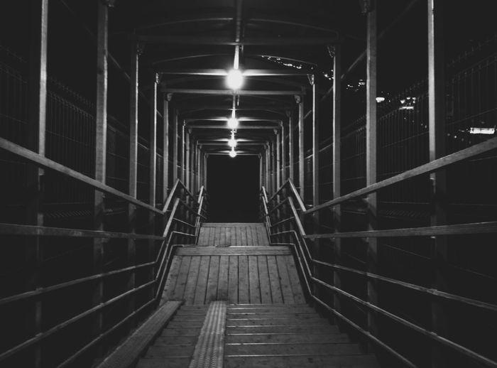 Illuminated The Way Forward Indoors  Lighting Equipment Narrow Corridor Flooring Long Diminishing Perspective In A Row Floor Surface Level Electric Light Fluorescent Light Lit Handrail  No People Passage