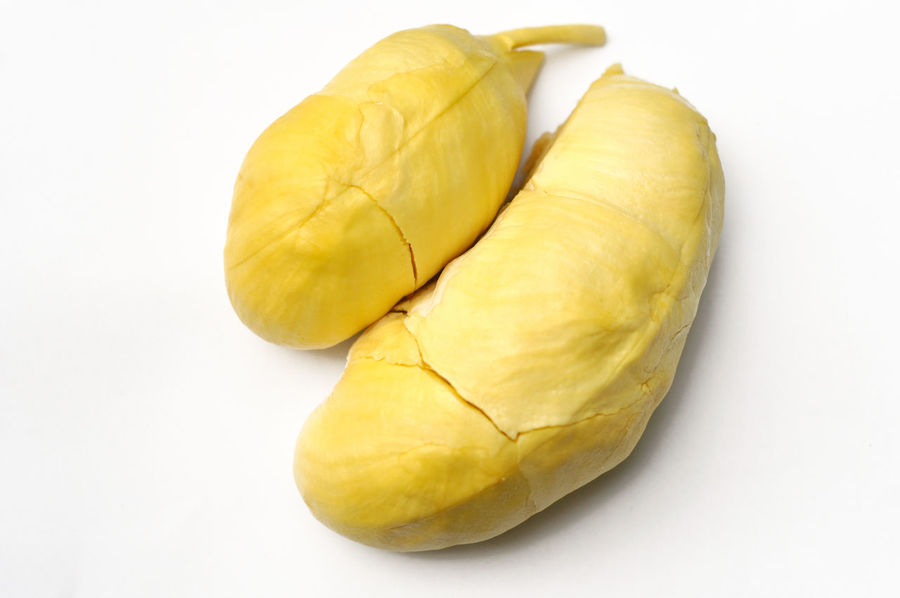 """Widely known and revered in southeast Asia as the """"king of fruits"""", the durian is distinctive for its large size, unique odour, and formidable thorn-covered husk. Durian Isolated Close-up Cut Out Food Food And Drink Freshness Fruit Thai Fruits White Background"""