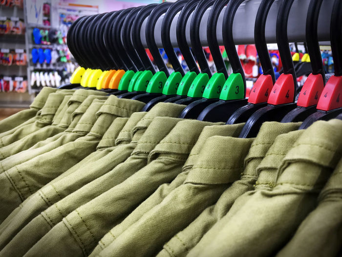 Same Style Clothes Hanging on Rack Abundance Arrangement Casual Clothing Choice Close-up Cloth Day Indoors  Large Group Of Objects Multi Colored No People Retail  Same  Shirt Store Style Textile Variation
