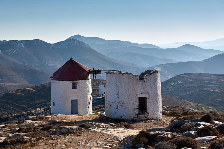 Amorgos Windmill Windmill Amorgos Architecture Beauty In Nature Building Building Exterior Built Structure Day Environment Greece House Landscape Mountain Mountain Range Nature No People Old Outdoors Remote Scenics - Nature Sky Tranquil Scene Tranquility