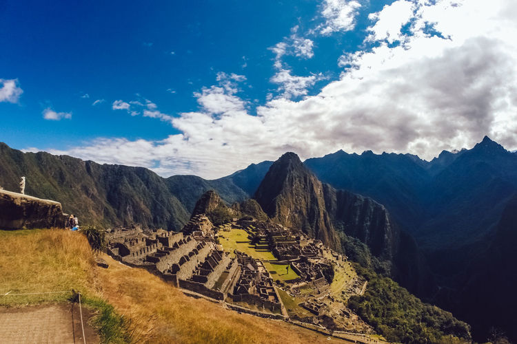 Scenic View Of Machu Picchu Against Cloudy Sky