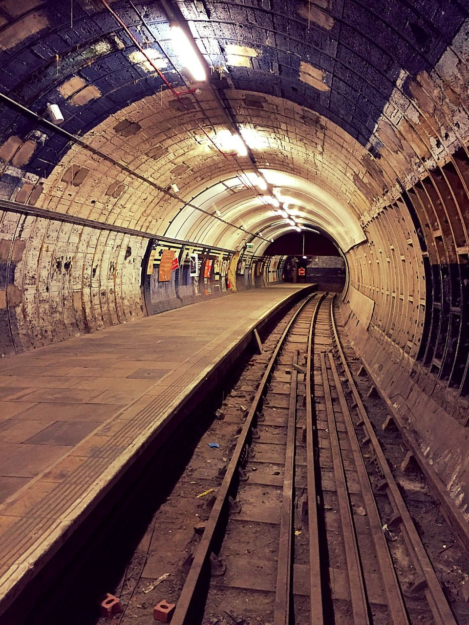 rail transportation, track, railroad track, transportation, public transportation, architecture, indoors, illuminated, mode of transportation, tunnel, railroad station, direction, diminishing perspective, the way forward, built structure, arch, subway, railroad station platform, travel, no people, ceiling, light, long, platform, station