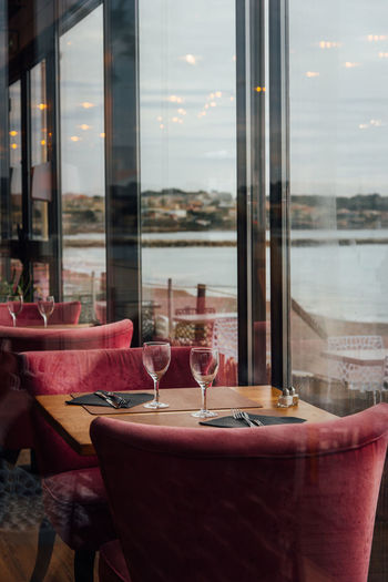 Glass of restaurant table by window.