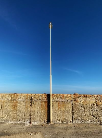 back Sky Blue Nature Day No People Wall Architecture Land Clear Sky Sunlight Street Light Wall - Building Feature Lighting Equipment Street