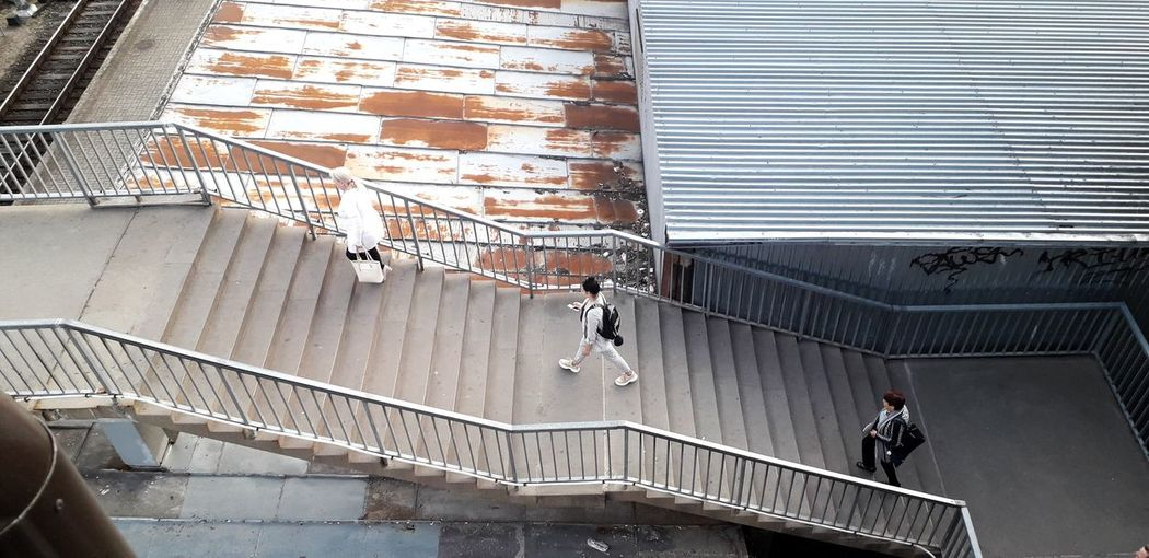 High angle view of people on staircase of building