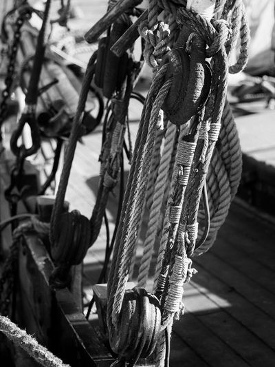 Close-up of rope tied to metal chain
