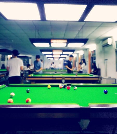 Pool Ball Pool Table Pool - Cue Sport Pool Cue Snooker Leisure Games Indoors  Playing Snooker And Pool Sport Leisure Activity Ball Enjoyment Green Color Snooker Ball Bar - Drink Establishment Real People Pool Hall Arts Culture And Entertainment Pub