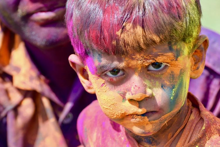 Portrait of boy covered in paint